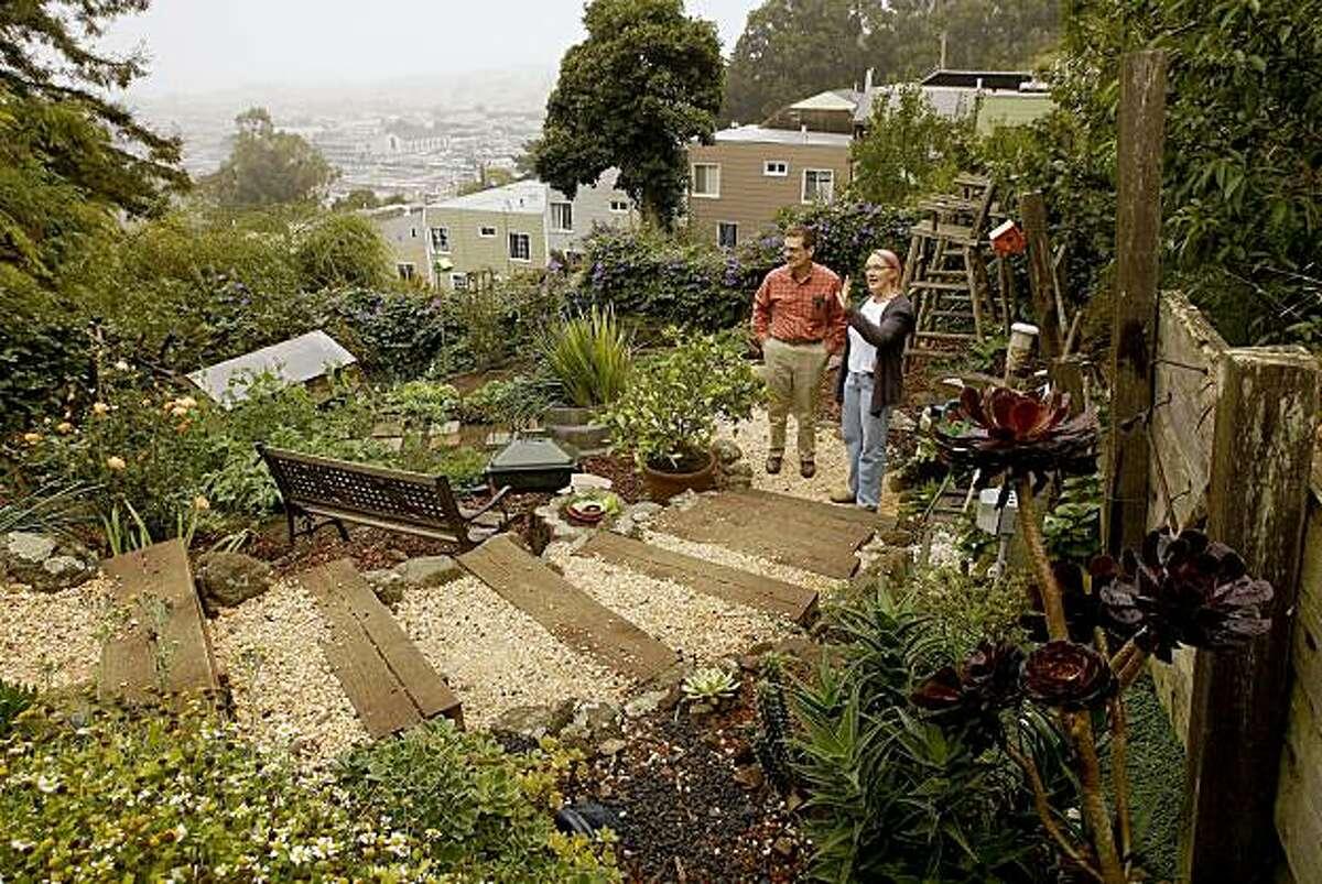 Ruth Wallace shows Russ Bartoli around her backyard garden.