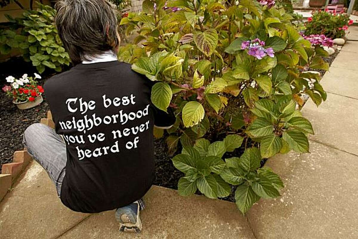 Toni Alvez in her backyard garden, which is one of the homes featured as part of the 3rd Annual Portola Garden Tour in San Francisco on Saturday.