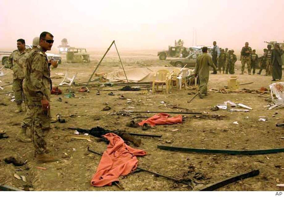 ###Live Caption:Iraqi security forces inspect the scene of a suicide bomb attack in the town of Albu Mohammed about 150 kilometers (90 miles) north of Baghdad, Thursday April 17, 2008. A suicide bomber struck the funeral of two anti-al-Qaida Sunni tribesmen in a town north of Baghdad on Thursday, killing at least 50 people and wounding dozens, police said. (AP Photo)###Caption History:Iraqi security forces inspect the scene of a suicide bomb attack in the town of Albu Mohammed about 150 kilometers (90 miles) north of Baghdad, Thursday April 17, 2008. A suicide bomber struck the funeral of two anti-al-Qaida Sunni tribesmen in a town north of Baghdad on Thursday, killing at least 50 people and wounding dozens, police said. (AP Photo)###Notes:###Special Instructions: Photo: AP PHOTO