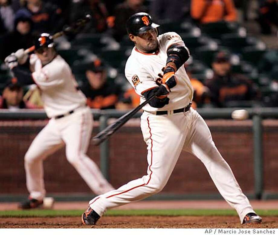 San Francisco Giants' Benji Molina hits a walk off home run off San Diego Padres reliever Cla Meredith in the 11th inning of a baseball game in San Francisco, Tuesday, April 8, 2008. San Francisco won 3-2. (AP Photo/Marcio Jose Sanchez) Photo: Marcio Jose Sanchez