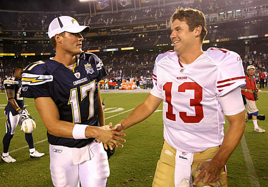 SAN DIEGO - SEPTEMBER 4:  Quarterback Philip Rivers #17 of the San Diego Chargers greets quarterback Shaun Hill #13 of the San Francisco 49ers after the game on September 4, 2009 at Qualcomm Stadium in San Diego, California.   The Chrgers won 26-7.  (Photo by Stephen Dunn/Getty Images) Photo: Stephen Dunn, Getty Images