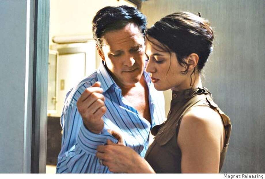 Asia Argento and Michael Madsen in BOARDING GATE, a Magnet Releasing film. Photo courtesy of Magnet Releasing. Photo: 1996-98 AccuSoft Inc.