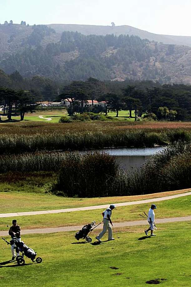 Golfers at Sharp Park Golf Course showing Salada Beach marsh in Pacifica Calif., on Monday, September 22, 2008.  Environmentalists are upset over the killing of two endangered species--red legged frog and garter snake-- which reside in the marsh. Photo: Liz Hafalia, The Chronicle