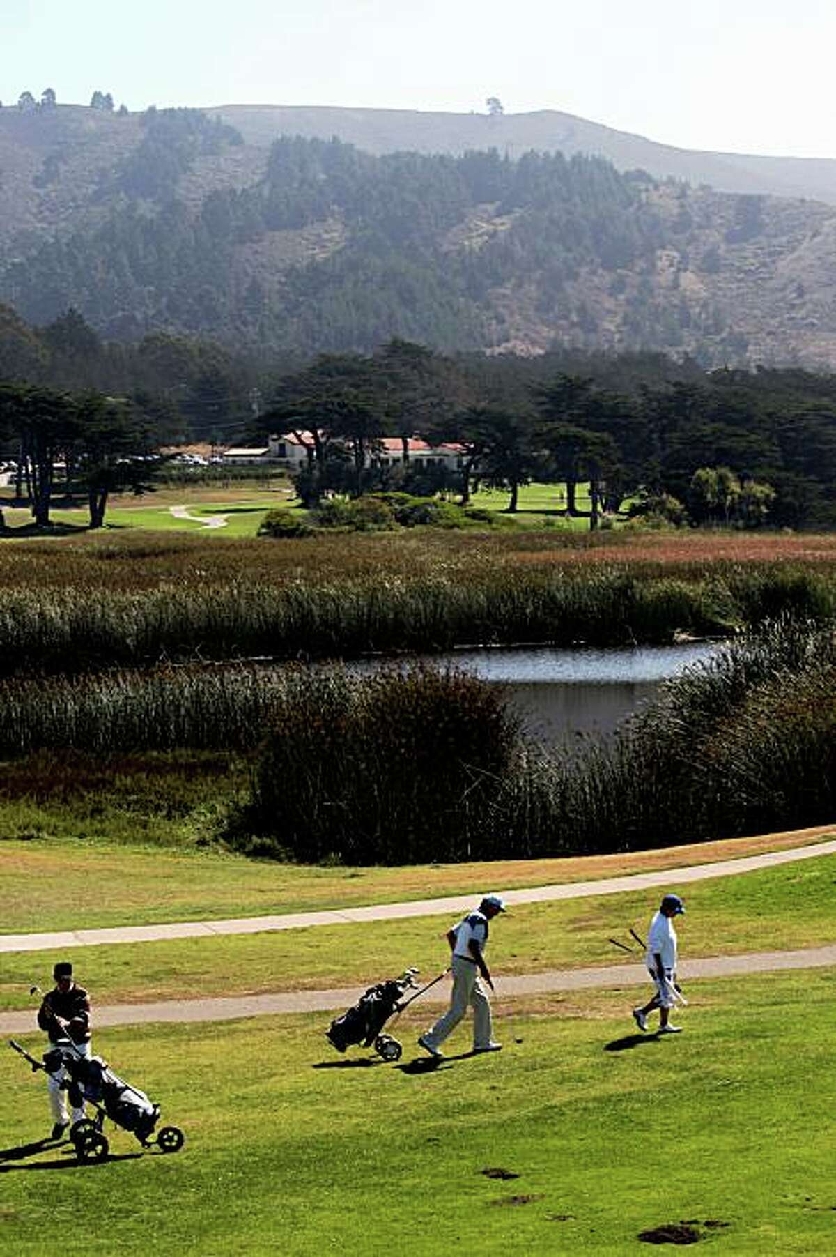 Golfers at Sharp Park Golf Course showing Salada Beach marsh in Pacifica Calif., on Monday, September 22, 2008. Environmentalists are upset over the killing of two endangered species--red legged frog and garter snake-- which reside in the marsh.