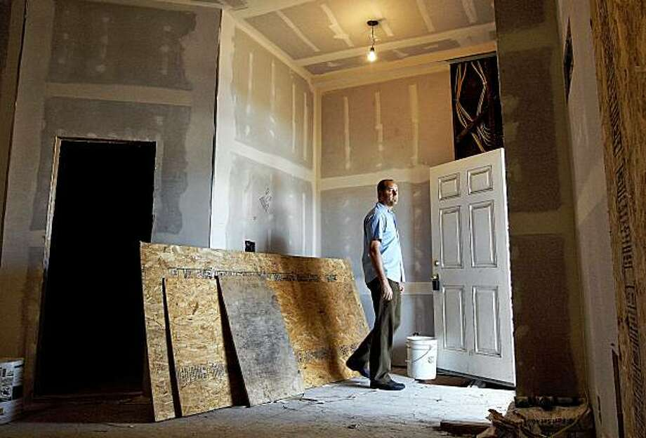 Nathan Foran, used his self-directed IRA to buy this foreclosure property in Richmond, Ca. for a price of $25,000. Foran inside the partially renovated property on Friday August 28, 2009. Photo: Michael Macor, The Chronicle