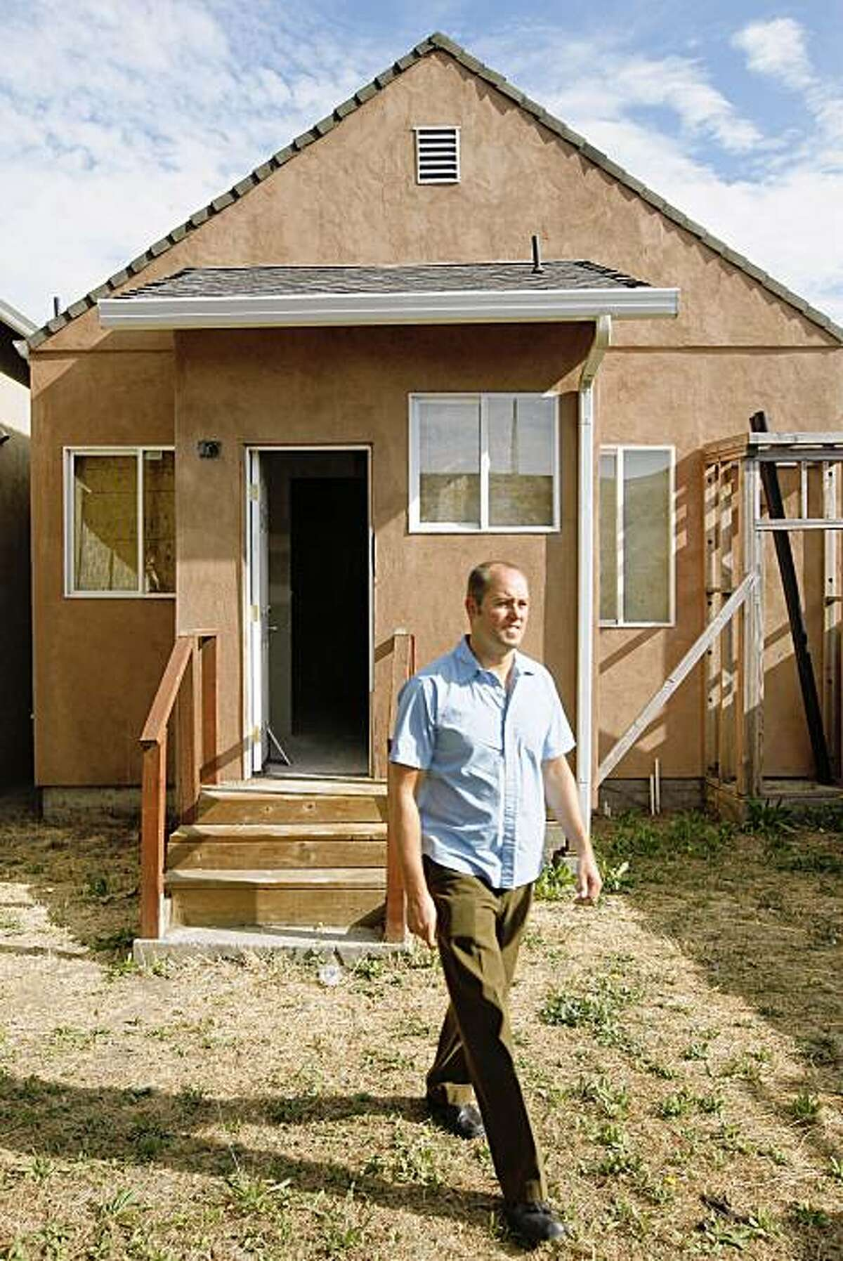 Nathan Foran, used his self-directed IRA to buy this foreclosure property in Richmond, Ca. for a price of $25,000. Foran in the small backyard of the partially renovated property on Friday August 28, 2009.