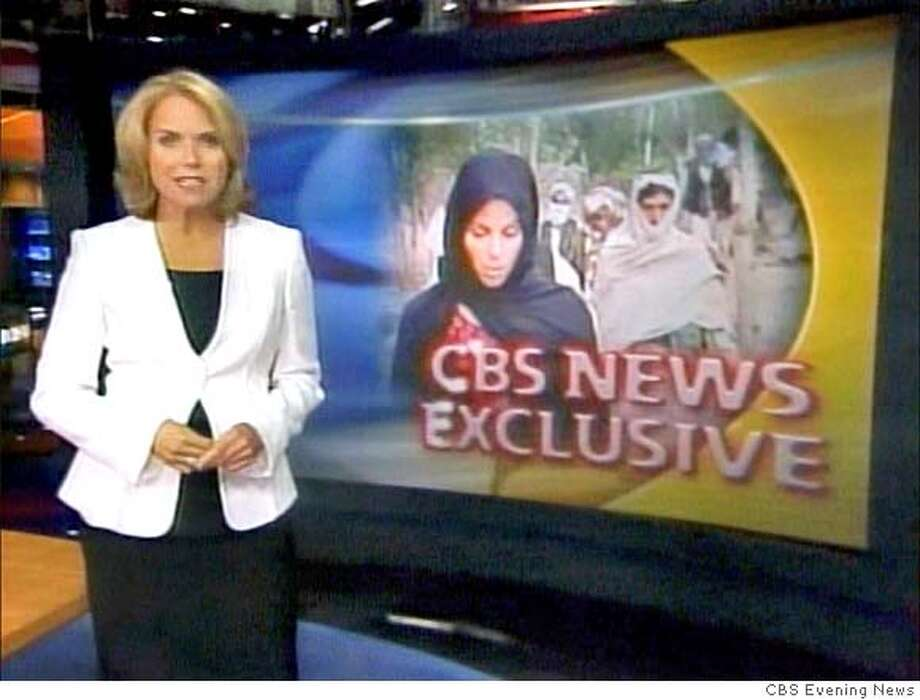 """Television footage shows Katie Couric debuting as """"CBS Evening News"""" anchor in New York, September 5, 2006. After 15 years as co-host of NBC's """"Today"""" show, Couric is filling the evening news chair vacated by Dan Rather and once occupied by Walter Cronkite, two of the best-known figures in U.S. television news. FOR ONE TIME EDITORIAL USE ONLY NO SALES NO ARCHIVE NORTH AMERICAN USE ONLY MANDATORY CREDIT REUTERS/CBS Evening News/Handout (UNITED STATES)  Ran on: 09-10-2006  Katie Couric's wardrobe is more clean-cut now that she's a news anchor. Photo: HO"""
