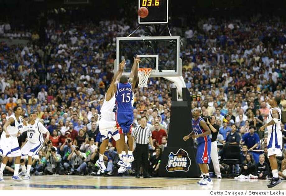 ###Live Caption:SAN ANTONIO - APRIL 07: Mario Chalmers #15 of the Kansas Jayhawks shoots and makes a three-pointer to tie the game to send it into overtime against the Memphis Tigers during the 2008 NCAA Men's National Championship game at the Alamodome on April 7, 2008 in San Antonio, Texas. (Photo by Streeter Lecka/Getty Images)###Caption History:SAN ANTONIO - APRIL 07: Mario Chalmers #15 of the Kansas Jayhawks shoots and makes a three-pointer to tie the game to send it into overtime against the Memphis Tigers during the 2008 NCAA Men's National Championship game at the Alamodome on April 7, 2008 in San Antonio, Texas. (Photo by Streeter Lecka/Getty Images)###Notes:Kansas v Memphis###Special Instructions: Photo: Streeter Lecka