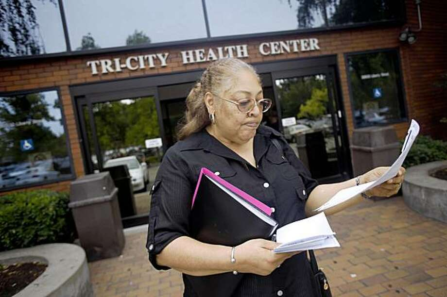 Inge Marie Phillips of Newark looks over her lab forms outside of Tri-City Health Center where she picked up the request for lab work in Fremont, Calif. on Monday, August 31, 2009. Photo: Lea Suzuki, The Chronicle