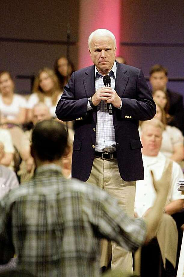 Sen. John McCain, R-Ariz., listens to a question from the crowd at a health care town hall meeting Wednesday, Aug. 26, 2009 in Phoenix. (AP Photo/Ross D. Franklin) Photo: Ross D. Franklin, AP