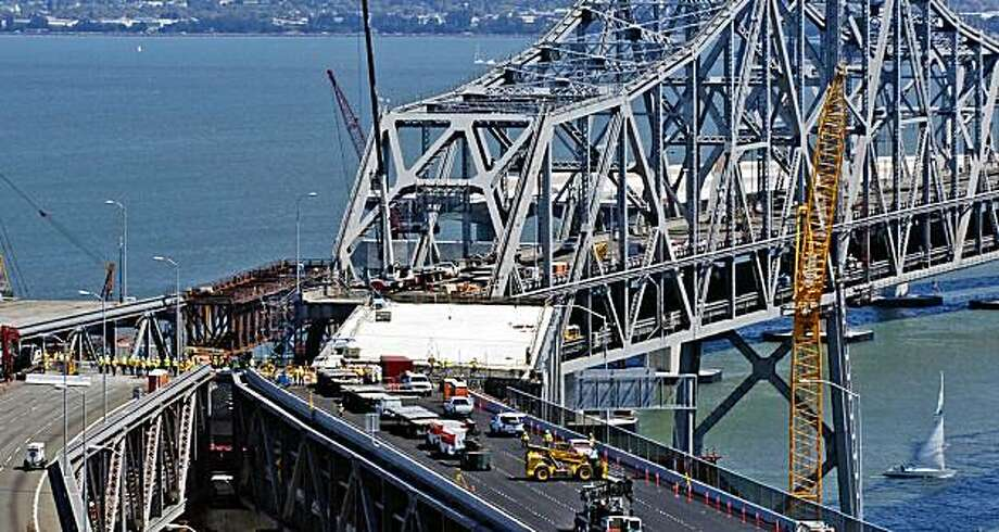 A replacement section slides into place connecting the new detour route during the San Francisco-Oakland Bay Bridge seismic retrofit in San Francisco, Saturday, Sept. 5, 2009. The bridge is closed over the Labor Day weekend and expected to reopen before morning rush hour Tuesday. (AP Photo/Russel A. Daniels) Photo: Russel A. Daniels, AP