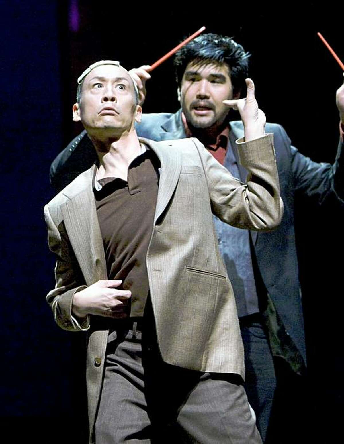 Pun Bandhu (right) as playwright D.H.H. with Francis Jue as his father H.Y.H. in David Henry Hwang's