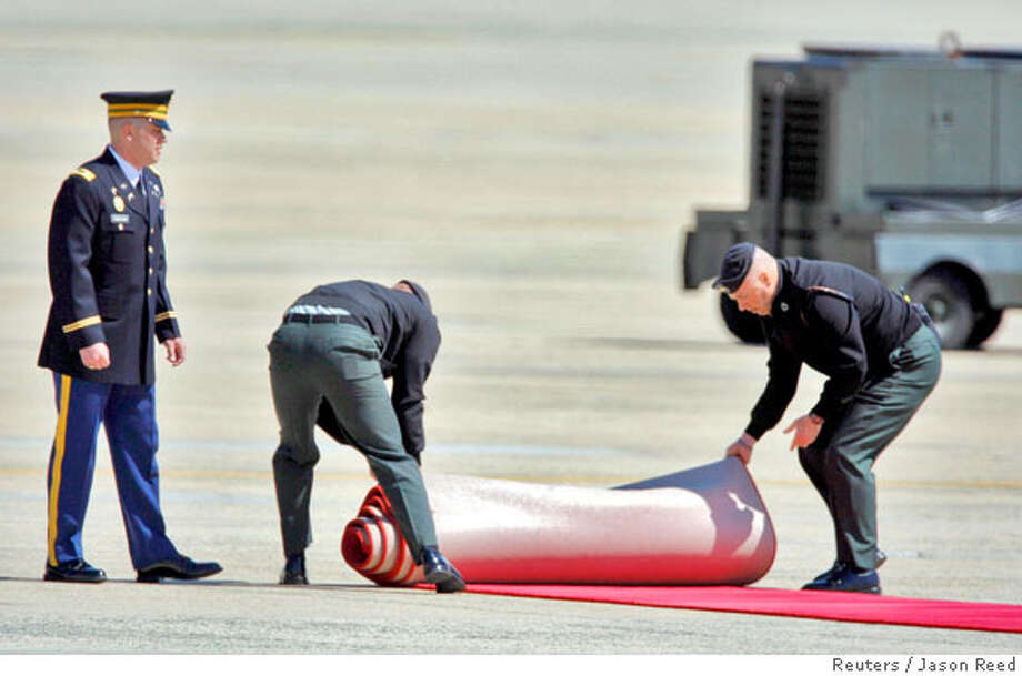 Members of the U.S. Air Force roll out a red carpet for the arrival of Pope Benedict XVI at Andrews Air Force Base outside Washington April 15, 2008. The Pope is beginning a six-day trip to the United States, during which he will pray at Ground Zero in New York, address the United Nations and try to heal wounds from a sexual abuse scandal. REUTERS/Jason Reed (UNITED STATES) Photo: JASON REED