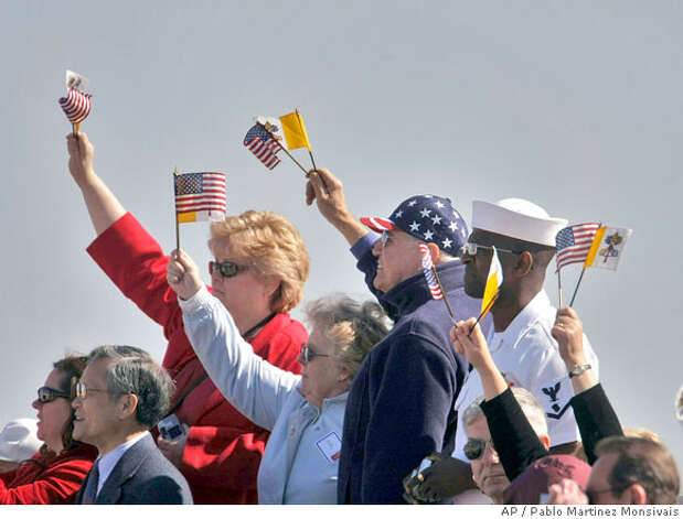 Spectators waves upon the arrival of Pope Benedict XVI, Tuesday, April 15, 2008, at Andrews Air Force Base in Maryland. (AP Photo/Pablo Martinez Monsivais) Photo: Pablo Martinez Monsivais