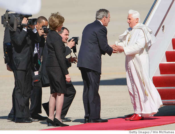 CAMP SPRINGS, MD - APRIL 15: Pope Benedict XVI (R) shakes hands with U.S. President George W. Bush (C) as first Lady Laura Bush looks on, upon his arrival in the United States April 15, 2008 at Andrews Air Force Base, Maryland. Pope Benedict will spend three days in Washington DC, including a visit to the White House tomorrow before continuing onto New York City. (Photo by Win McNamee/Getty Images) Photo: Win McNamee