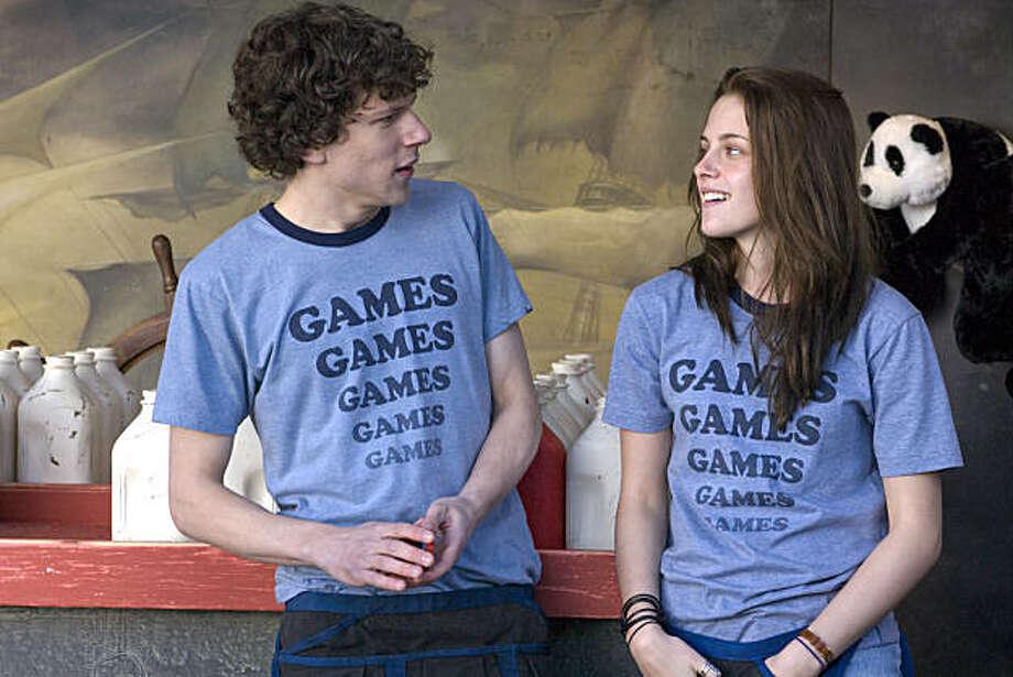 """Jesse Eisenberg as James Brennan, Kristen Stewart as Em Lewin in """"Adventureland."""" Photo: Abbot Genser, Miramax"""