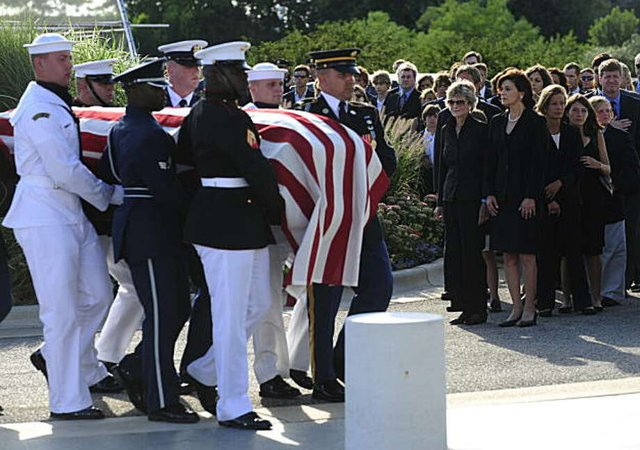 The coffin of Senator Edward Kennedy is carried by a honour guard past Jean Kennedy Smith and Victoria Kennedy leading the Kennedy family at the entrance of the John F. Kennedy Presidential Library and Museum where his body will lie in repose for two days,  in Boston on August 27, 2009. AFP PHOTO/Emmanuel Dunand (Photo credit should read EMMANUEL DUNAND/AFP/Getty Images) Photo: Emmanuel Dunand, AFP/Getty Images