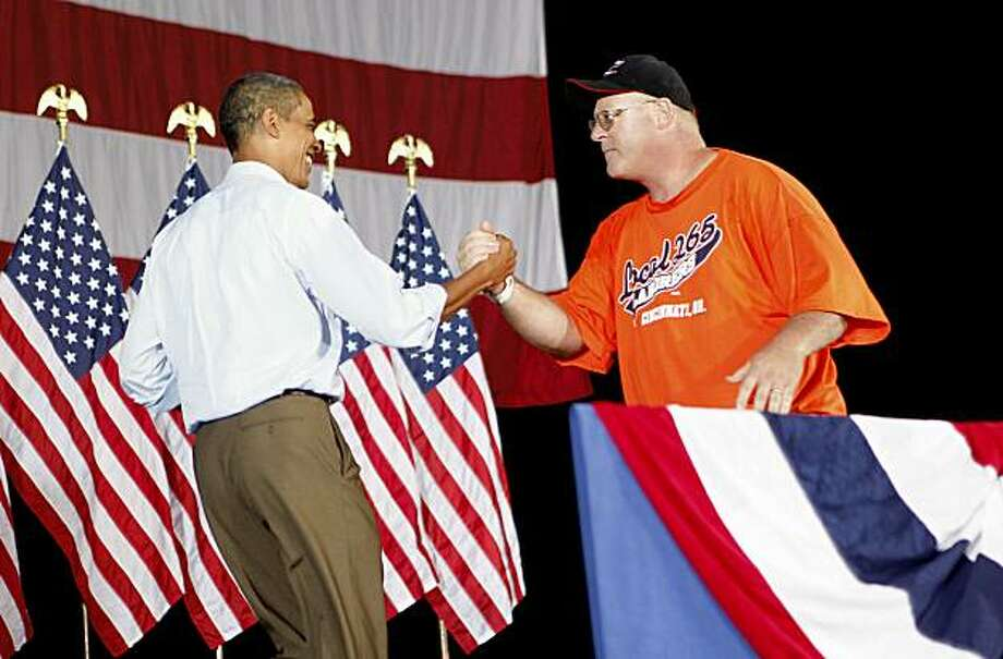 President Barack Obama is introduced by Charlie Dilbert, 45, who works at A&A Safety, which installs road signs and concrete barriers, before he spoke at the AFL-CIO Labor Day picnic at Coney Island in Cincinnati, Monday, Sept. 7, 2009. (AP Photo/Charles Dharapak) Photo: Charles Dharapak, AP