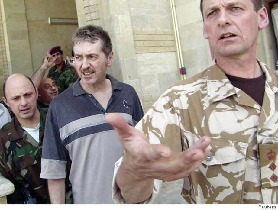 ###Live Caption:British journalist Richard Butler (C) walks with British (R) and Iraqi (L) military officers in an Iraqi army camp in Basra, 550 km (342 miles) south of Baghdad April 14, 2008. Butler, who was held for two months by kidnappers in the southern Iraqi city of Basra, was rescued on Monday by Iraqi forces sweeping through the city in a crackdown on militants, the Iraqi military said. REUTERS/Stringer (IRAQ)###Caption History:British journalist Richard Butler (C) walks with British (R) and Iraqi (L) military officers in an Iraqi army camp in Basra, 550 km (342 miles) south of Baghdad April 14, 2008. Butler, who was held for two months by kidnappers in the southern Iraqi city of Basra, was rescued on Monday by Iraqi forces sweeping through the city in a crackdown on militants, the Iraqi military said. REUTERS/Stringer (IRAQ)###Notes:British journalist Richard Butler walks in an Iraqi army camp in Basra###Special Instructions:0 Photo: STRINGER/IRAQ