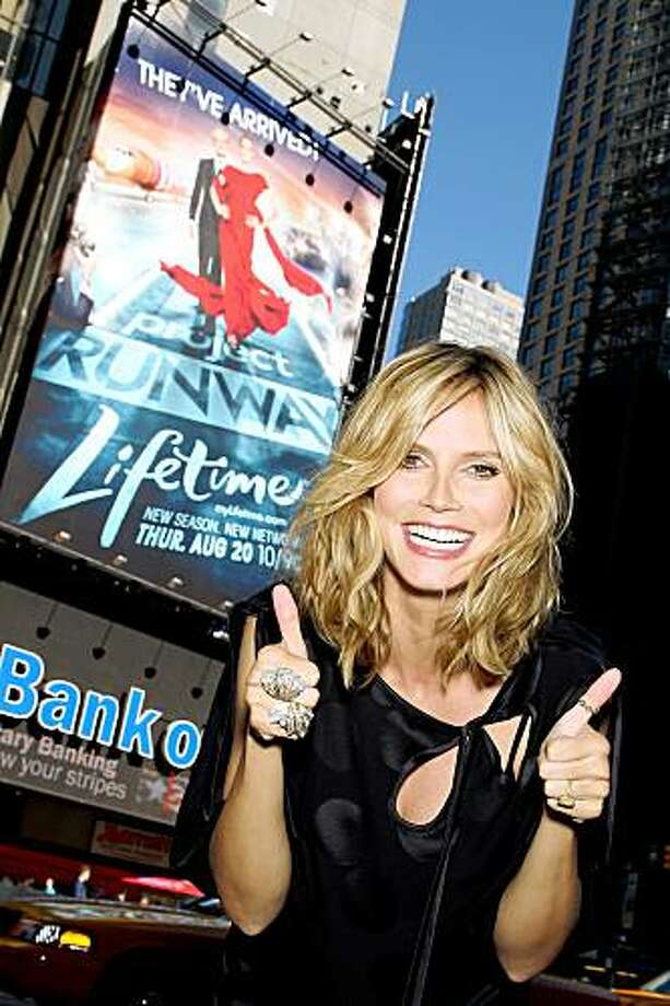 In this photo provided by StarPix, model Heidi Klum poses near a billboard in New York's Times Square, Wednesday, July 8, 2009. The billboard is for the new season of Project Runway on the Lifetime network.  (AP Photo/Marion Curtis, StarPix) Photo: Marion Curtis, StarPix, AP