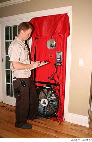Sustainable Spaces rep Jason Bowers conducting a blower door test on a house (not mine). Photo: Adam Winter