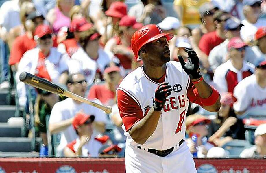 Los Angeles Angels' Torii Hunter hits a three-run home run during the fifth inning of a baseball game against the Oakland Athletics, Sunday, Aug. 30, 2009, in Anaheim, Calif.  (AP Photo/Mark J. Terrill) Photo: Mark J. Terrill, AP