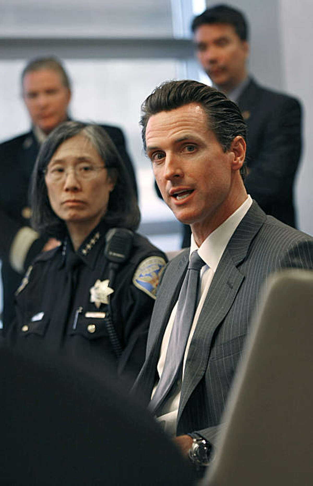 San Francisco Polic Chief Heather Fong, left, and Mayor Gavin Newsom explain their decisions regarding the Olympic Torch Relay at a press conference at San Francisco International Airport on Wednesday, April 9, 2008 Photo by Kim Komenich / San Francisco Chronicle