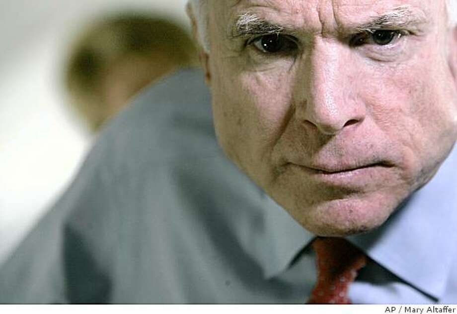 Republican presidential candidate, Sen. John McCain, R-Ariz., speaks to reporters aboard his campaign plane en route to Pittsburgh, Pa., Monday, April 14, 2008. (AP Photo/Mary Altaffer) Photo: Mary Altaffer, AP