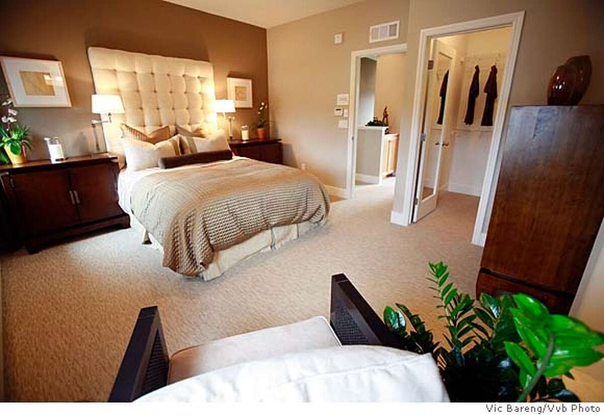 ###Live Caption:Master bedroom -- Village Square will include 15 buildings with a total of 95 three-level units plus a small park. The six basic floor plans range from about 1,342 to about 1,647 square feet with prices from $499,000 to $649,000.###Caption History:Master bedroom -- Village Square will include 15 buildings with a total of 95 three-level units plus a small park. The six basic floor plans range from about 1,342 to about 1,647 square feet with prices from $499,000 to $649,000.###Notes:###Special Instructions: