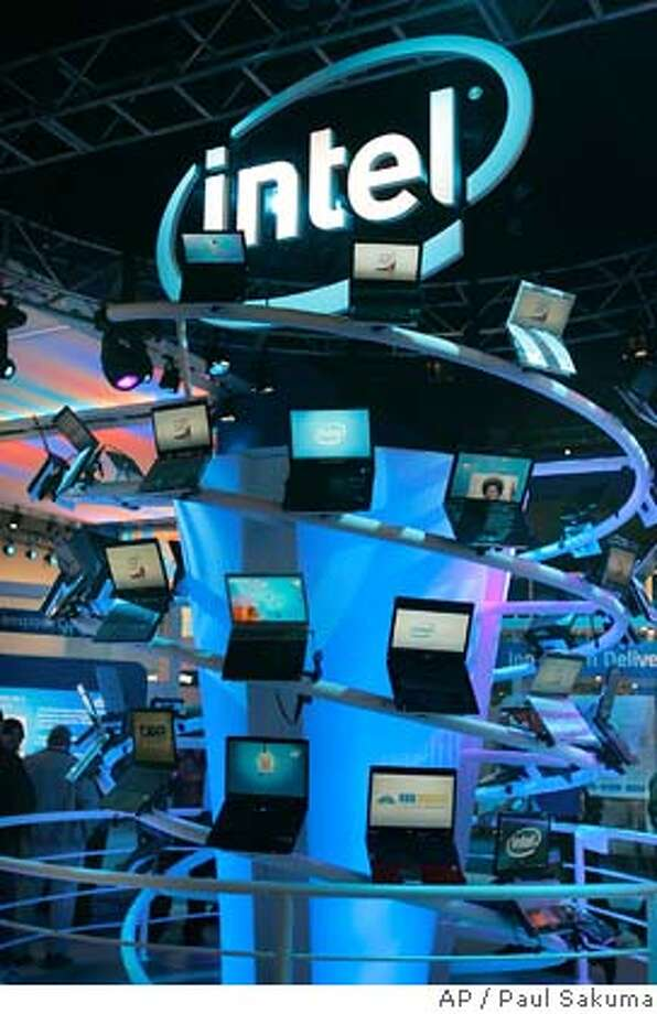 The Intel exhibit at the Consumer Electronics Show at the Las Vegas Convention Center is seen Wednesday, Jan. 9, 2008. Intel is expected to release quarterly earnings after market close Tuesday, Jan. 15, 2008. (AP Photo/Paul Sakuma)  Ran on: 01-16-2008  Things looked good for Intel at last week's Consumer Electronics Show in Las Vegas, but the company's stock got hit hard in after-hours trading Tuesday because fourth-quarter results fell short. Photo: Paul Sakuma