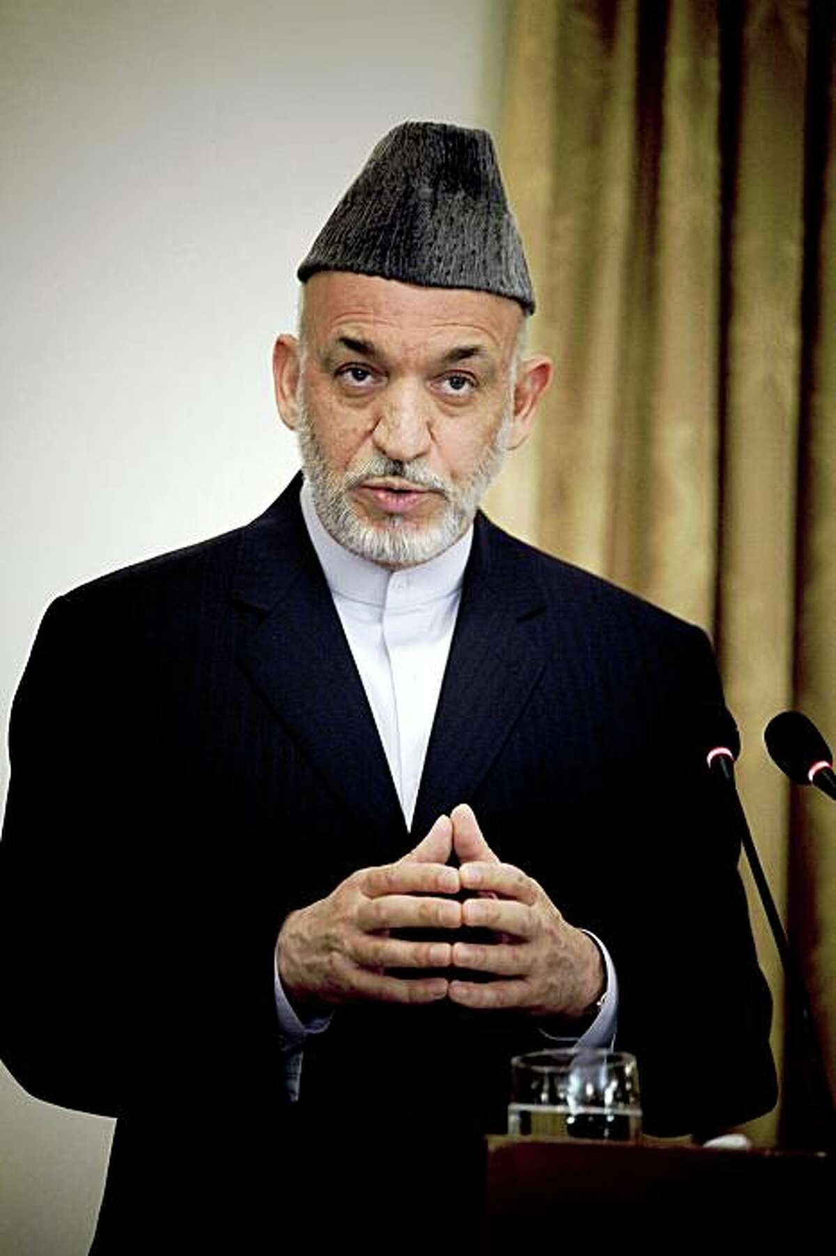 President Hamid Karzai speaks to reporters during a news conference in Kabul, Afghanistan, on June 17, 2009. With a nationwide election only weeks away, the paradox of Karzai has never seemed more apparent: He is at once deeply unpopular and likely to win. (Eros Hoagland/The New York Times)