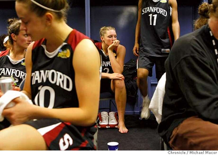 A somber Stanford locker room with, Stanford's Jillian Harmon, left, JJ Hones front and Stanford's Jayne Appel,.background. Stanford Cardinals battle the Lady Volunteers of Tennessee in the Women's NCAA Championship game, on April 8, 2008 in Tampa, Floirda.  Photo by Michael Macor/ San Francisco Chronicle Photo: Michael Macor