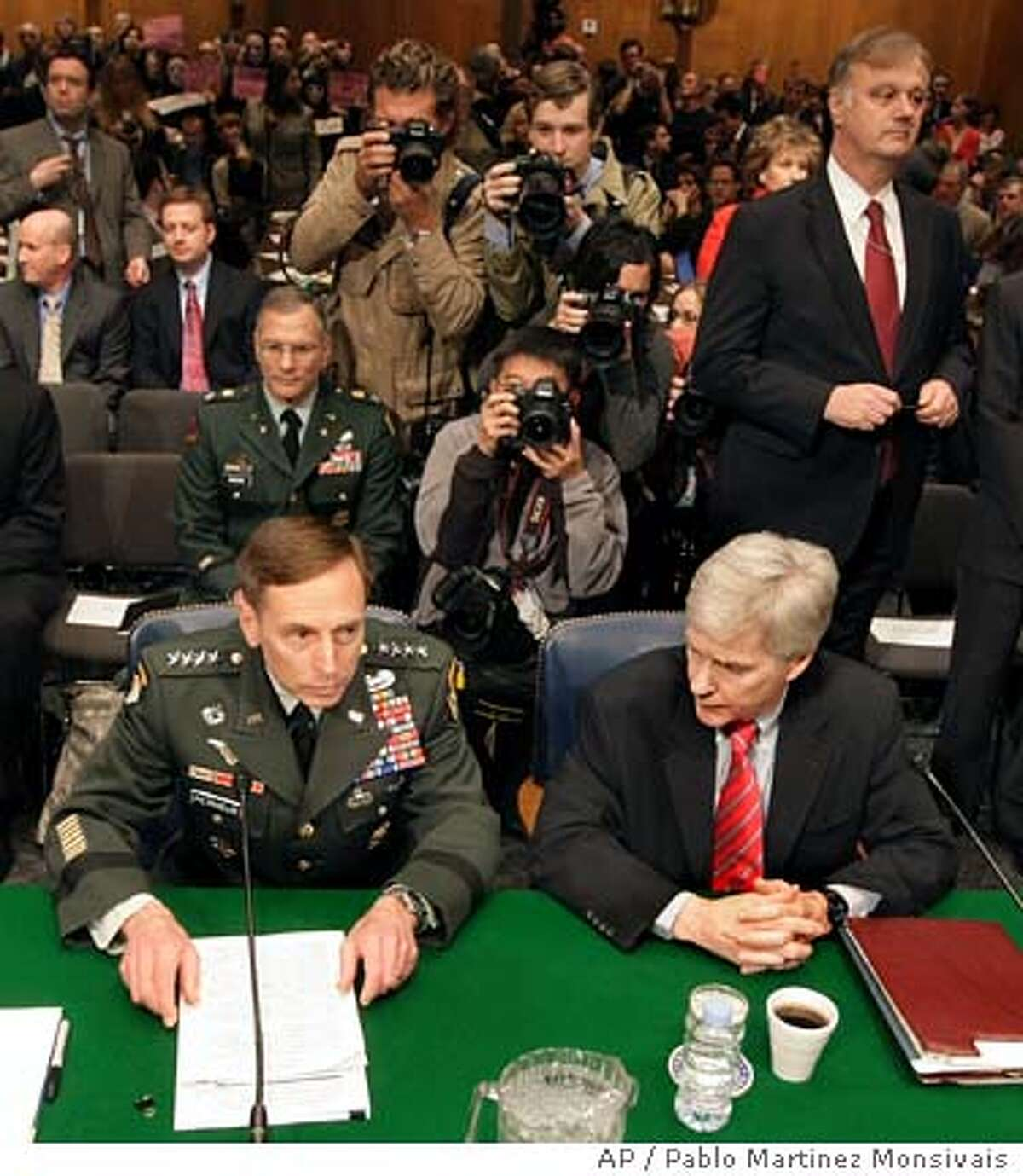 Gen. David Petraeus, left, and Amb. Ryan Crocker prepare to testify on Capitol Hill in Washington, Tuesday, April 8, 2008, before the Senate Armed Services Committee hearing on the status of the war in Iraq. (AP Photo/Pablo Martinez Monsivais)