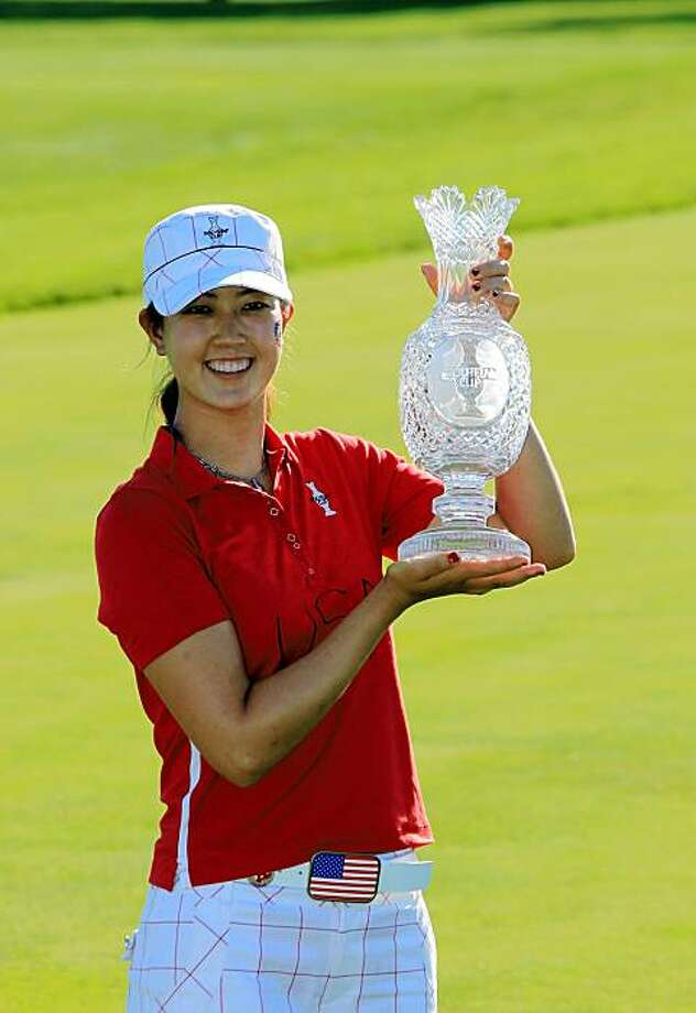 SUGAR GROVE, IL - AUGUST 23: Michelle Wie of the USA with the trophy after the Sunday singles matches at the 2009 Solheim Cup Matches, at the Rich Harvest Farms Golf Club on August 23, 2009 in Sugar Grove, Ilinois (Photo by David Cannon/Getty Images) Photo: David Cannon, Getty Images