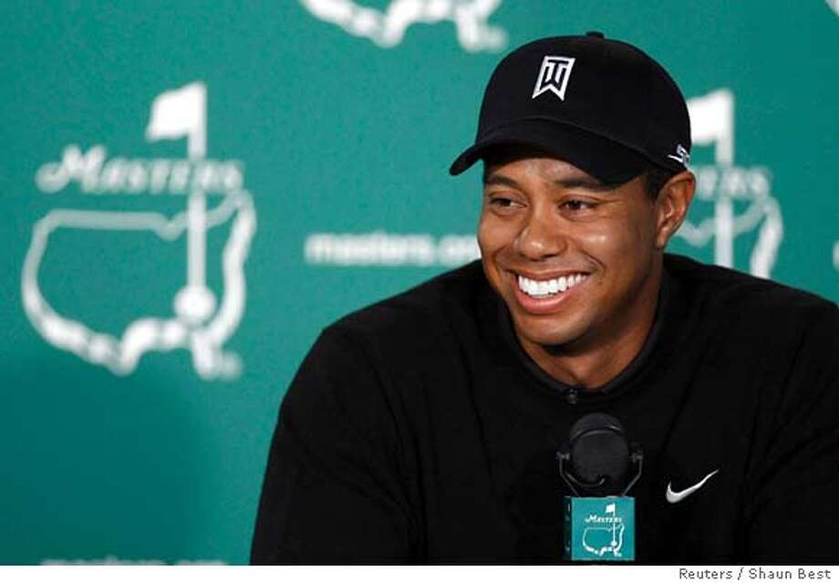 Tiger Woods of the U.S. speaks at a news conference after his practice round for the 2008 Masters golf tournament at the Augusta National Golf Club in Augusta, Georgia April 8, 2008. REUTERS/Shaun Best (UNITED STATES)  Ran on: 04-09-2008  Tiger Woods has become the focal point of this year's event.  Ran on: 04-09-2008 Ran on: 04-09-2008 Photo: SHAUN BEST