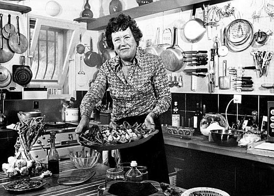 FILE- In this Aug. 21, 1978 file photo shows American television chef Julia Child showing a salade nicoise she prepared in the kitchen of her vacation home in Grasse, southern France.  More so than the tools and techniques she popularized,  Child's most lasting legacy may be her spirit and sense of humor. That was the conclusion of several chefs and food magazine editors asked to describe Child's memorable contributions to American home cooking as a new movie about her life is about to open. (AP Photo) Photo: Anonymous, AP