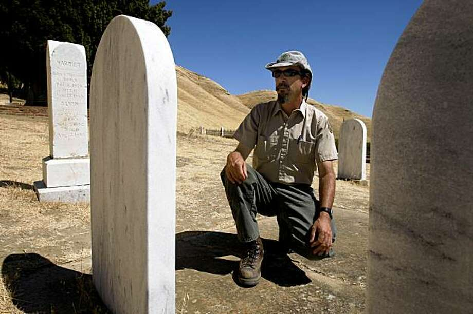 Park ranger Doug Fowler views one of the tombstones he recently restored in the Rose Hill Cemetery at Black Diamond Mines Regional Preserve in Antioch, Calif., on Thursday, Sept. 3, 2009. Photo: Paul Chinn, The Chronicle