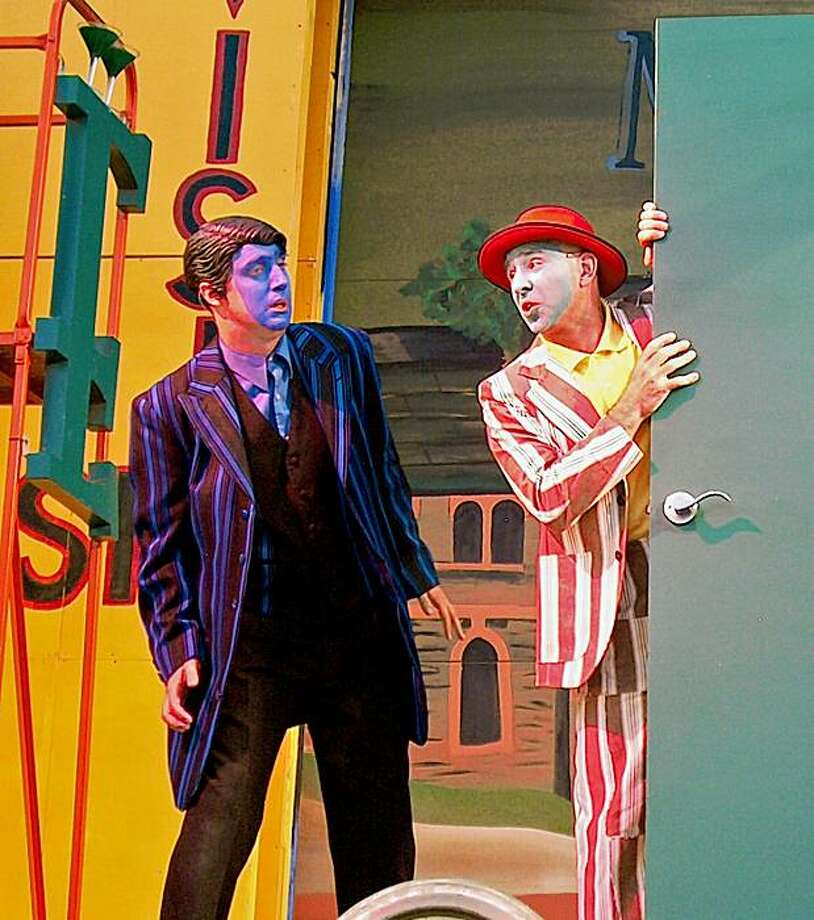 """Cassidy Brown (left) and Brian Herndon, as Antipholus and Dromio of Syracuse, get mixed up with their local twins in Ephesus in San Francisco Shakespeare Festival's """"The Comedy of Errors."""" Photo: John Western"""