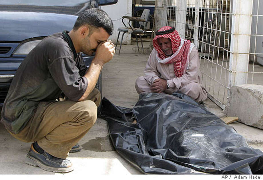 Family members of victims of a car bomb react in front of a hospital in Baqouba, 60 kilometers (35 miles) northeast of Baghdad, Tuesday, April 15, 2008. According to police and hospital officials, at least 38 people were killed and 64 wounded in the blast when a car parked in front of a restaurant in downtown Baqouba exploded, just before noon on Tuesday, across the street from the central courthouse and other government offices. (AP Photo/Adem Hadei) Photo: ADEM HADEI