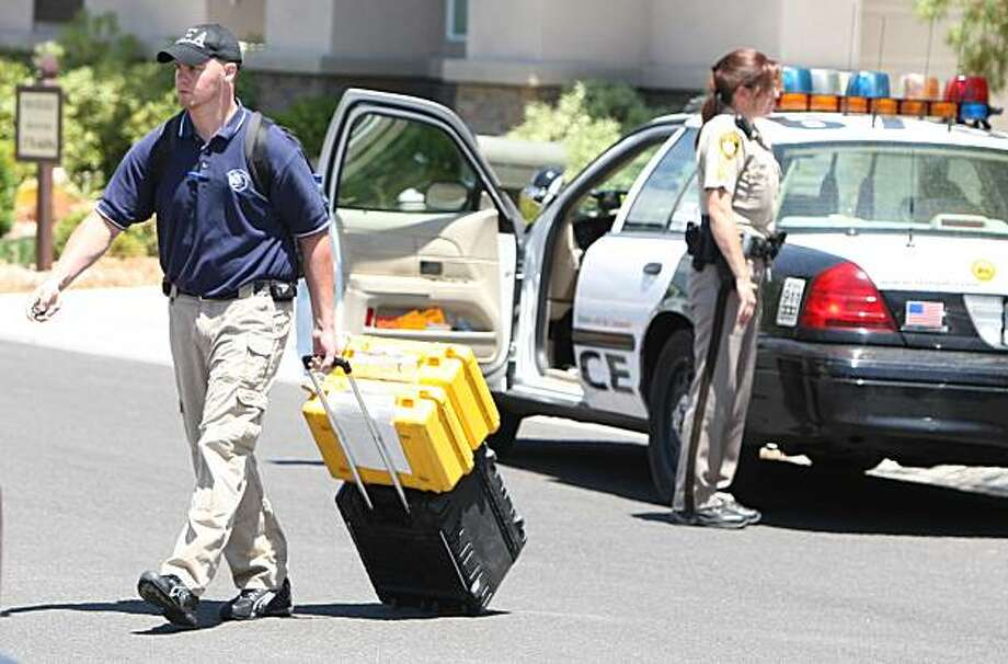 FILE- In this July 28,2009 file photo, authorities leave the scene after executing a search warrant at the Red Rock Canyon Country Club residence of Dr. Conrad Murray, in Las Vegas. The Los Angeles County coroner has ruled Michael Jackson's death a homicide. The finding makes it more likely criminal charges will be filed against Murray who was with the pop star when he died. (AP Photo/Daniel Gluskoter, File) Photo: Daniel Gluskoter, AP