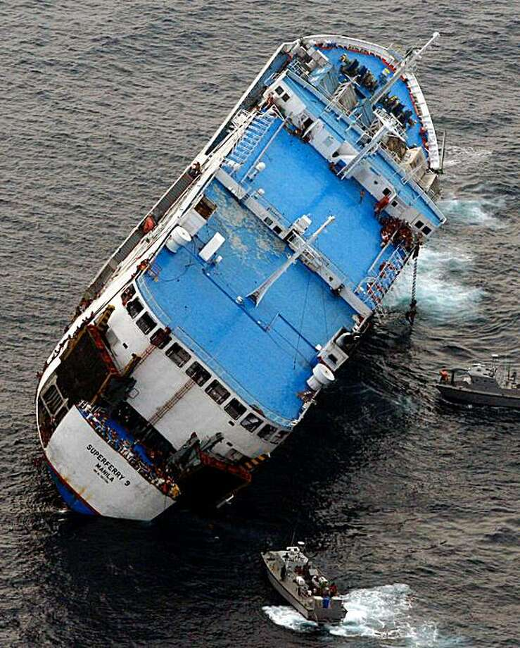 TOPSHOTS This handout photo released on September 6, 2009 by the Philippine navy shows the Superferry 9 listing to its side as naval boats approach off Zamboanga peninsula.  Five people were killed and dozens were left missing after a ferry carrying nearly 1,000 passengers sank in darkness off the southern Philippines on September 6, officials said.   RESTRICTED TO EDITORIAL USE  GETTY OUT     AFP PHOTO / Philippine Navy / HO (Photo credit should read AFP/AFP/Getty Images) Photo: AFP, AFP/Getty Images