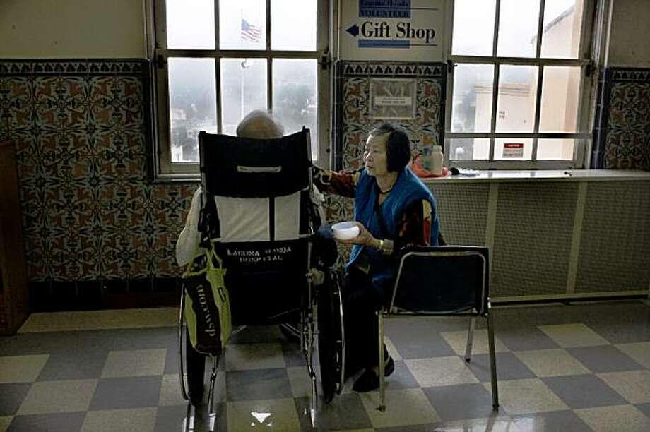 Cui Qim Liao Yu feeding her husband at Laguna Honda, the nation's largest city-funded nursing home in San Francisco, Calif.,  on Monday, July 20, 2009. Photo: Liz Hafalia, The Chronicle
