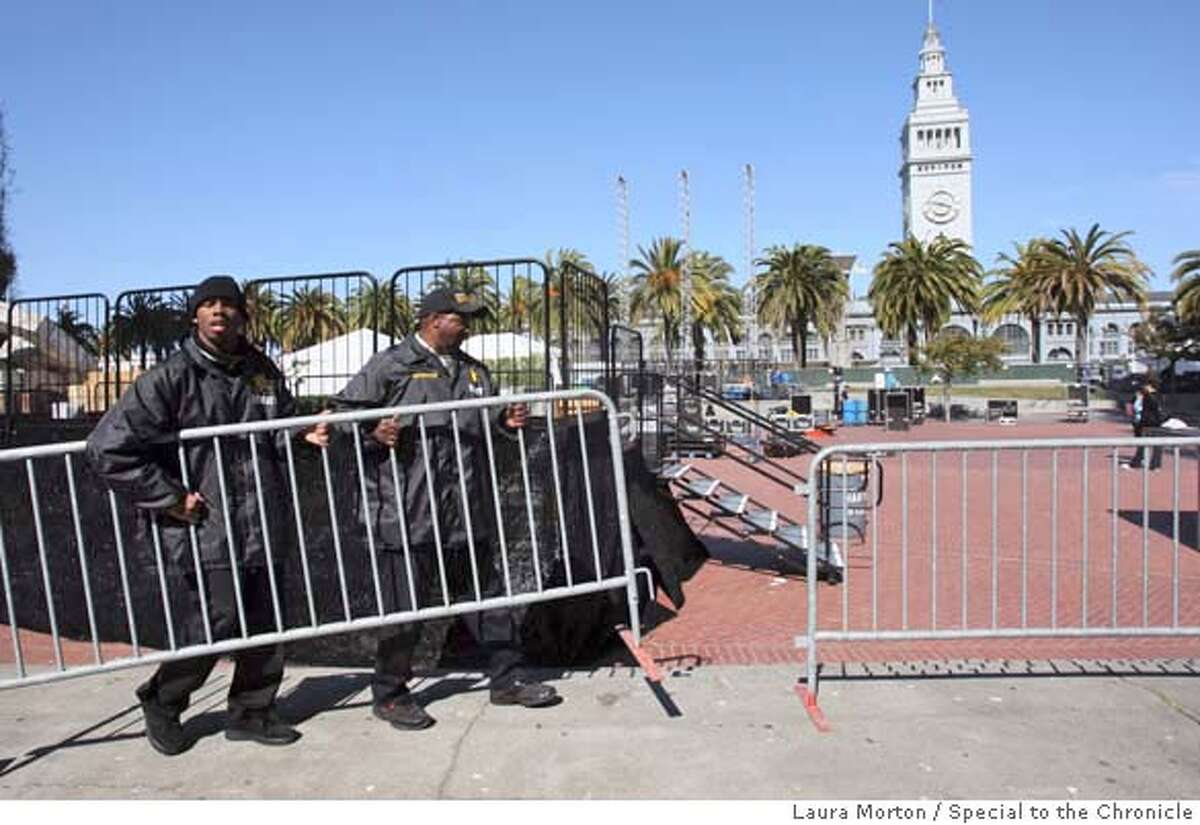 ###Live Caption:Russell Simms and Robert Patton (left) set up barriers around what will be the stage for the closing ceremonies of Wednesday's Olympic touch relay at the Embarcadero Plaza in San Francisco, Calif., on Monday, April 7, 2008. Photo by Laura Morton / Special to The Chronicle###Caption History:Russell Simms and Robert Patton (left) set up barriers around what will be the stage for the closing ceremonies of Wednesday's Olympic touch relay at the Embarcadero Plaza in San Francisco, Calif., on Monday, April 7, 2008. Photo by Laura Morton / Special to The Chronicle###Notes:Russell Simms Robert Patton###Special Instructions: