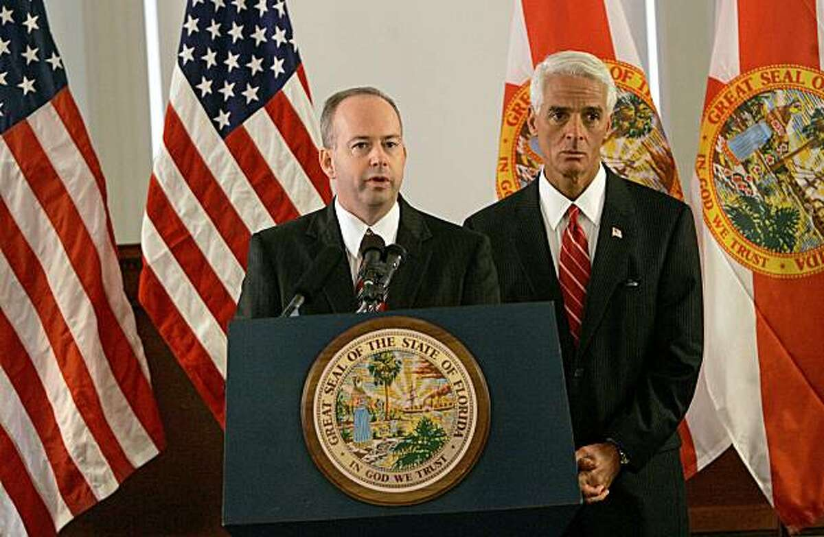 George LeMieux, left, former chief of staff to Gov. Charlie Crist, right, answers questions from the media after being named to replace U. S. Senator Mel Martinez, Friday, Aug. 28, 2009, in Tallahassee, Fla. (AP Photo/Phil Coale)