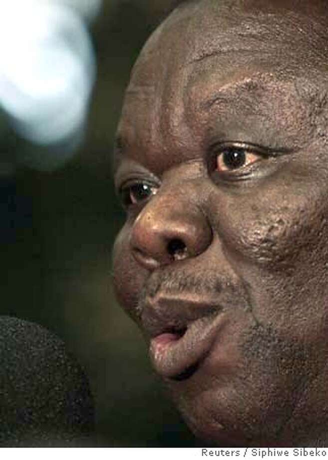 ###Live Caption:Movement for Democratic Change (MDC) leader, Morgan Tsvangirai, speaks during a radio interview at the studios in Johannesburg April 17, 2008. Zimbabwe's government on Thursday accused Tsvangirai of treason and of working with former colonial power Britain to topple President Robert Mugabe in recent elections. REUTERS/Siphiwe Sibeko (SOUTH AFRICA)###Caption History:Movement for Democratic Change (MDC) leader, Morgan Tsvangirai, speaks during a radio interview at the studios in Johannesburg April 17, 2008. Zimbabwe's government on Thursday accused Tsvangirai of treason and of working with former colonial power Britain to topple President Robert Mugabe in recent elections. REUTERS/Siphiwe Sibeko (SOUTH AFRICA)###Notes:Movement for Democratic Change leader Tsvangirai speaks during a radio interview at the studios in Johannesburg###Special Instructions:0 Photo: SIPHIWE SIBEKO