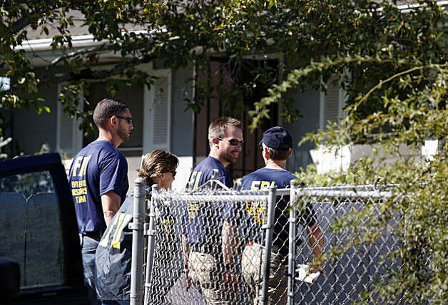 FBI investigators get ready to search a home (background) for clues in the 18-year-old kidnapping case of Jaycee Dugard in Antioch, Calif., on Thursday, Aug. 27, 2009. Dugard walked into a police station yesterday to announce that she was kidnapped near South Lake Tahoe in 1991. Authorities have taken Phillip Craig Garrido into custody. Photo: Paul Chinn, The Chronicle