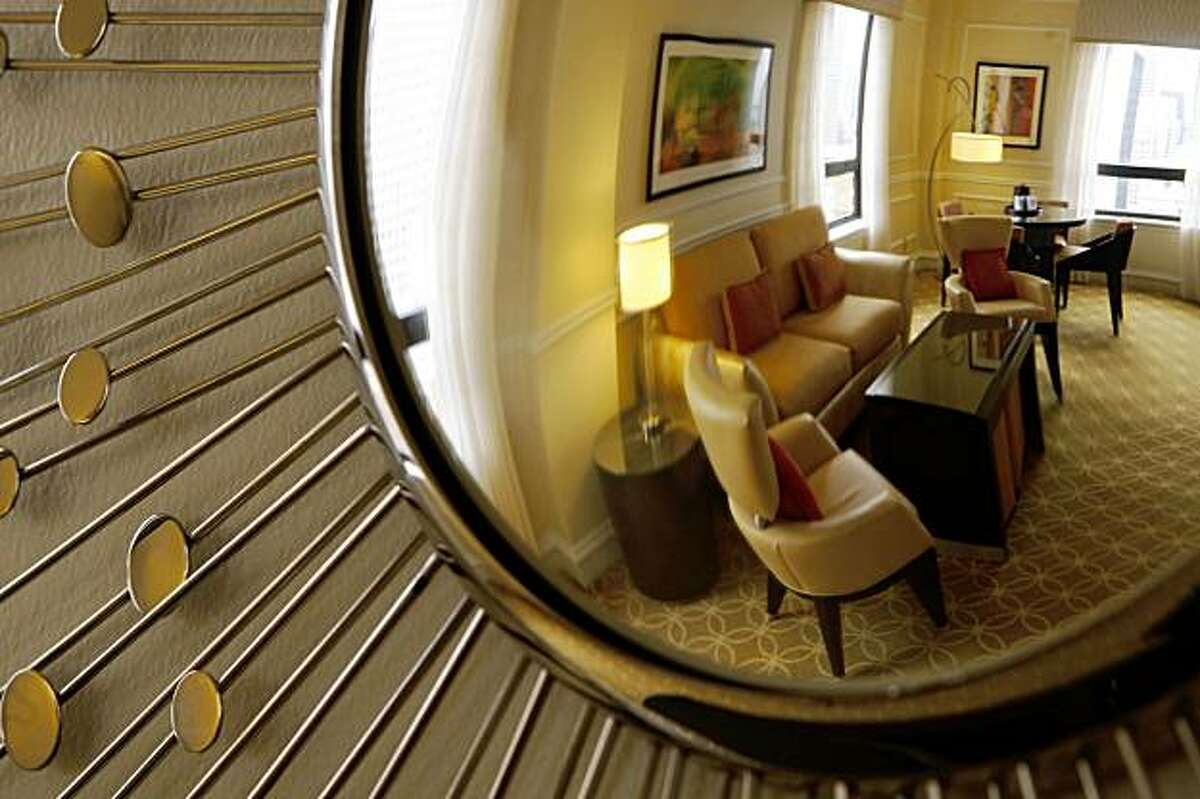 The sitting room in a suite is seen reflected in a mirror at the Stanford Court Hotel in San Francisco, Calif. on Thursday, August 20, 2009.
