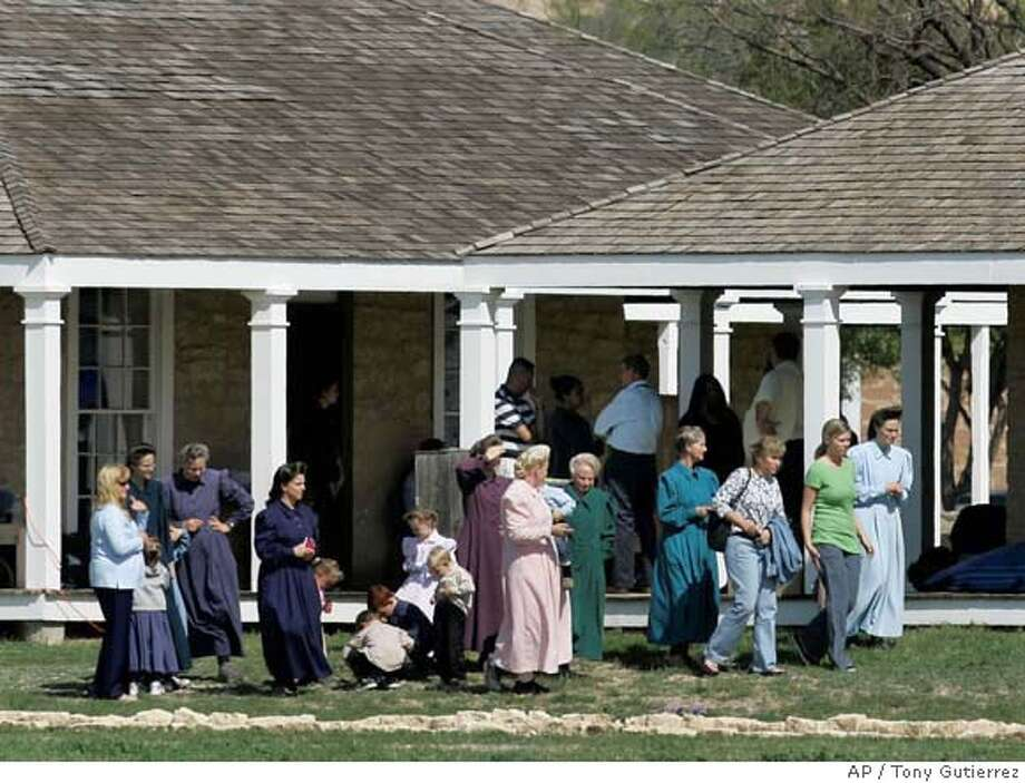 ###Live Caption:**CORRECTS SPELLING OF SECT NAME TO LATTER-DAY'**Members of the Fundamentalist Church of Jesus Christ of Later Day Saints, walk along the grounds of their temporary housing, Fort Concho National Historic Landmark, in San Angelo, Texas, Monday, April 7, 2008. (AP Photo/Tony Gutierrez)###Caption History:**CORRECTS SPELLING OF SECT NAME TO LATTER-DAY'**Members of the Fundamentalist Church of Jesus Christ of Later Day Saints, walk along the grounds of their temporary housing, Fort Concho National Historic Landmark, in San Angelo, Texas, Monday, April 7, 2008. (AP Photo/Tony Gutierrez)###Notes:###Special Instructions:**CORRECTS SPELLING OF SECT NAME TO LATTER-DAY'** Photo: Tony Gutierrez