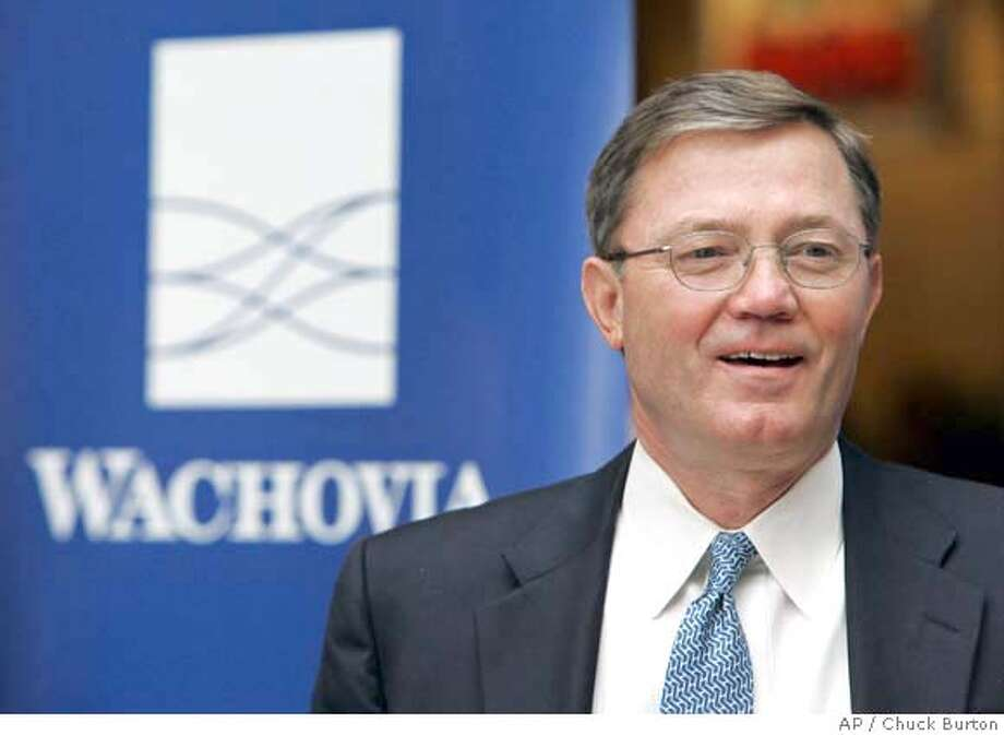 ** CORRECTS AMOUNT OF LOSS TO $393 MIL ** Wachovia CEO Ken Thompson talks to employees at the bank's corporate headquarters in Charlotte, N.C., Thursday, Feb. 21, 2008. Wachovia will slash its dividend and raise $7 billion in a share sale after reporting a surprising first-quarter loss Monday of $393 million before preferred dividends. (AP Photo/Chuck Burton) Photo: Chuck Burton
