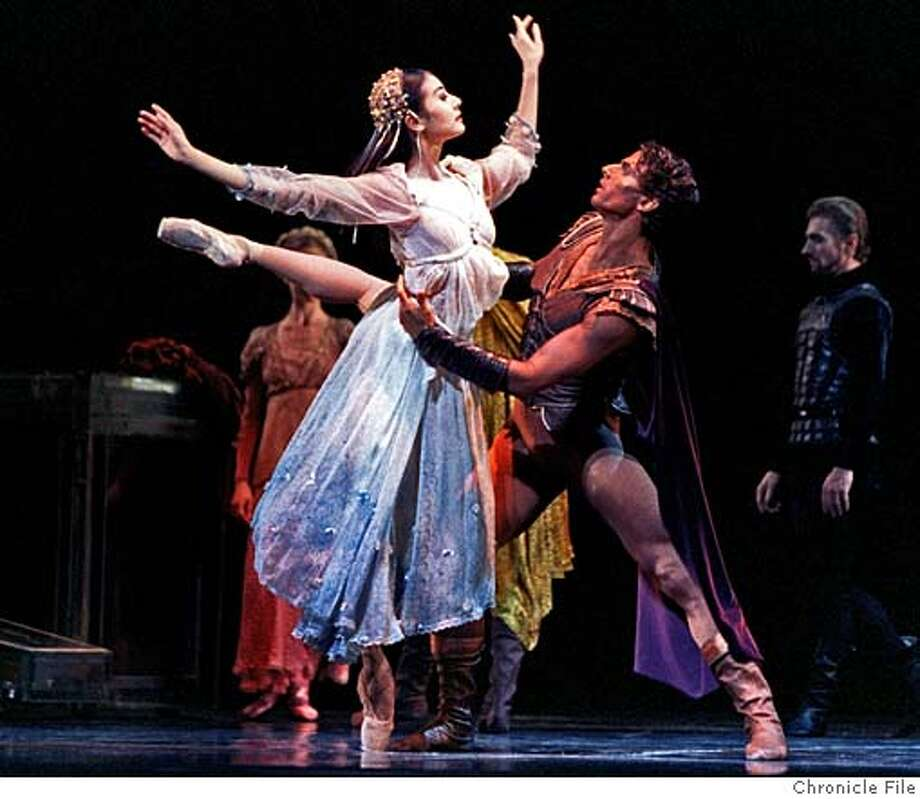 """###Live Caption:Yuan Yuan Tan and Yuri Possokhov dance in SF Ballet's West Coast premiere of choreographer Lar Lubovitch's """"Othello"""" in 1998###Caption History:OTHELLO 3/C/31MAR98/DD/JLT Yuan Yuan Tan and Yuri Possokhov dance the roles of Desdemona and Othello in SF Ballet's West Coast Premiere production of choreographer Lar Lubovitch's """"Othello"""" at the SF Opera House. PHOTO BY JERRY TELFER###Notes:###Special Instructions:CAT Photo: JERRY TELFER"""